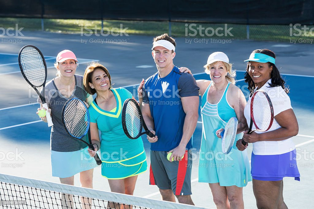 Mature women with tennis instructor stock photo