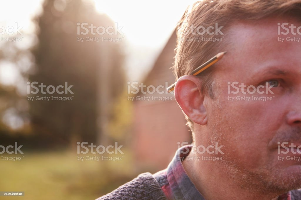 Mature Workman With Pencil Behind His Ear stock photo