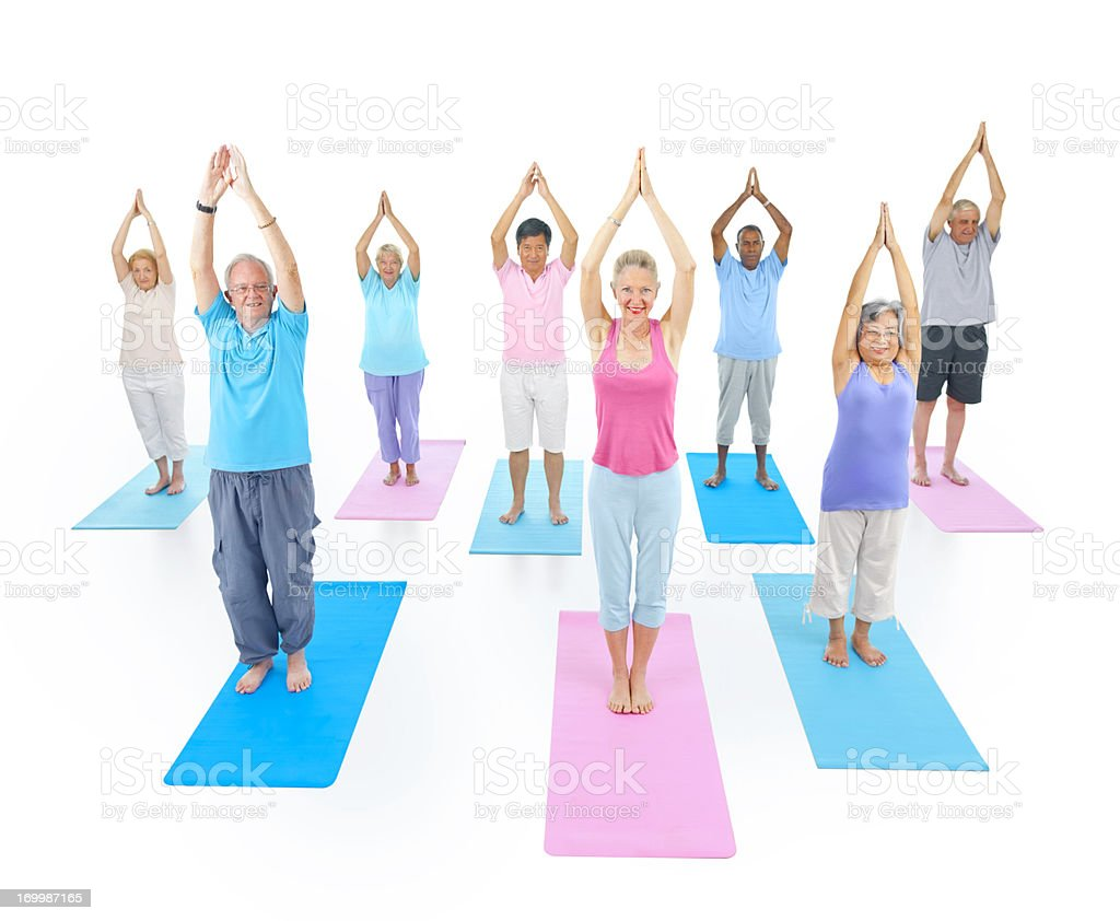 Mature Yoga class on white background royalty-free stock photo