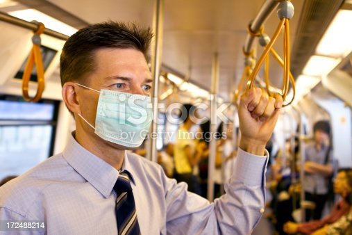 istock Matured business man wearing a protective mask in subway 172488214