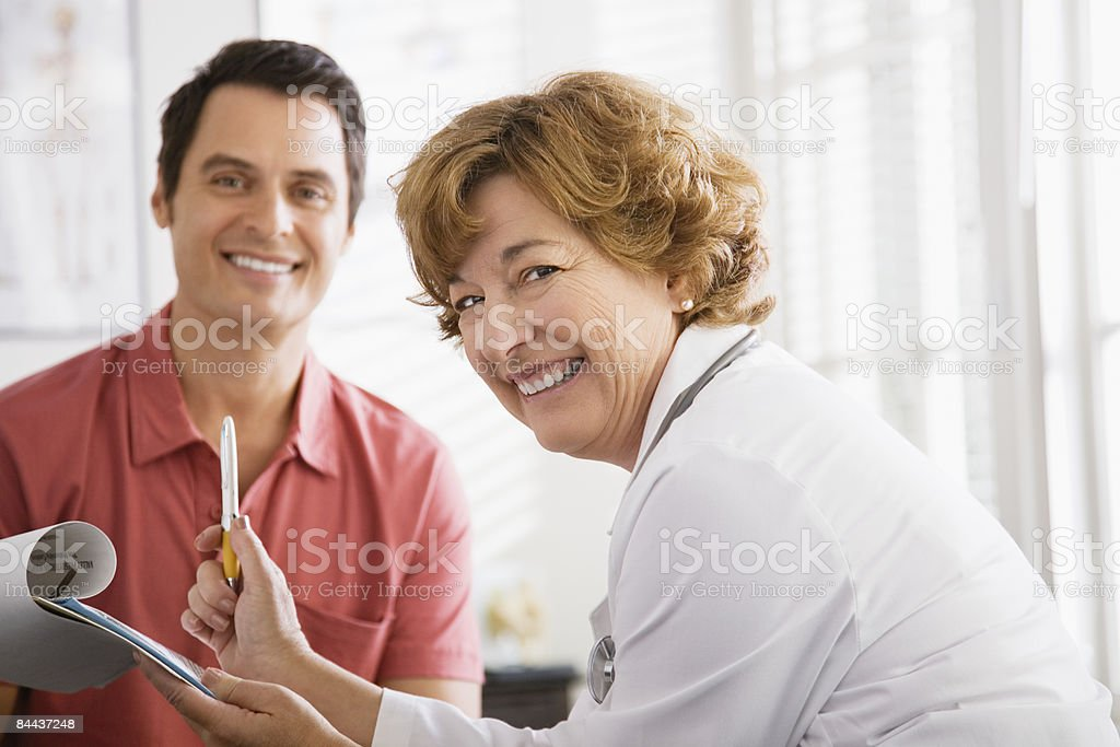 Matured Female Doctor and Male Patient royalty-free stock photo