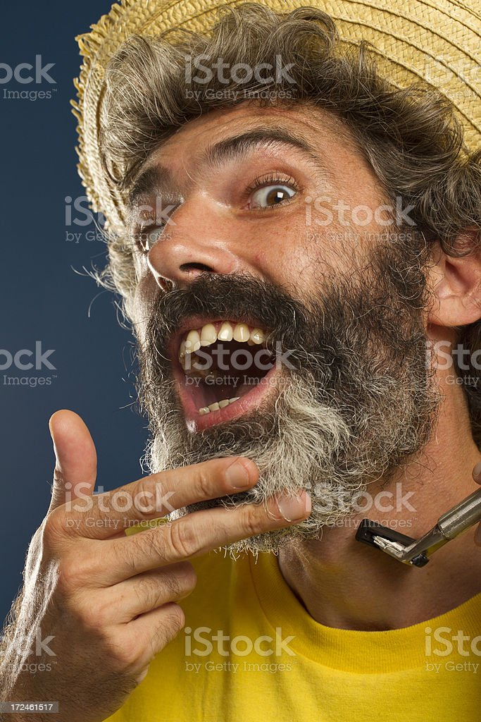 Matured man with beard having a shave royalty-free stock photo