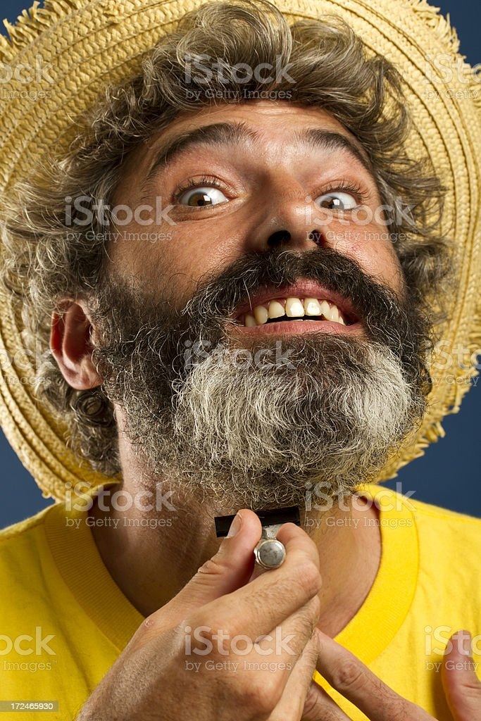 Matured man with long beard shaving royalty-free stock photo