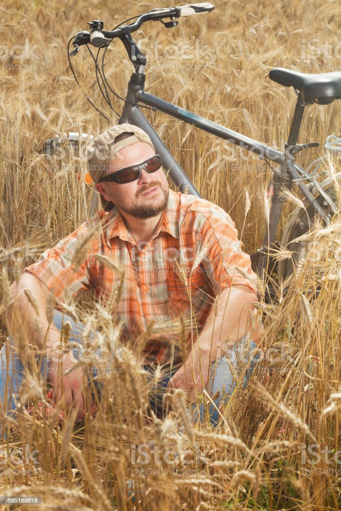 Matured traveller in cap and sunglasses having a res royalty-free stock photo