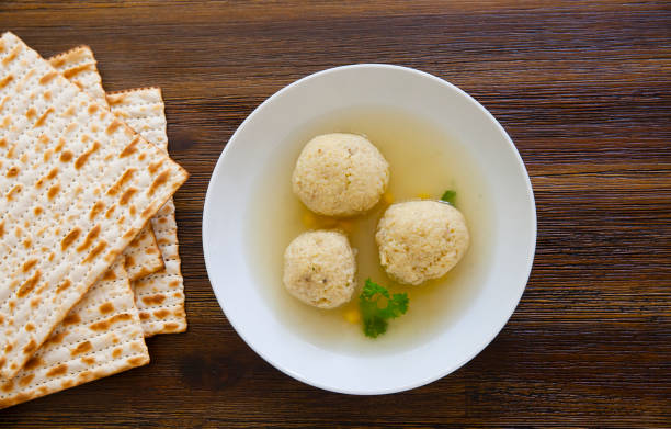 matzah ball soup - passover stock photos and pictures