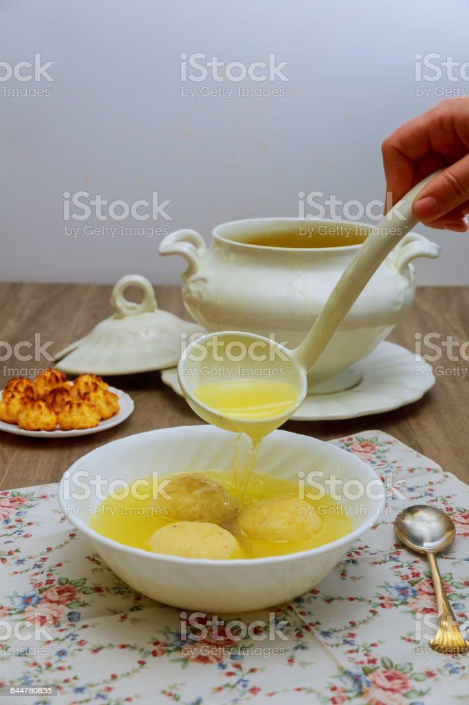 Matzah balls, Ashkenazi Jewish soup dumpling made from a mixture of matzah meal, eggs, water and chicken fat served on Passover Jewish Holiday. stock photo