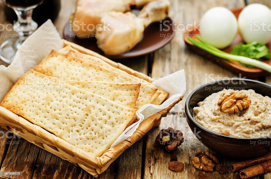 Matzah, wine, eggs, chicken, greens and haroset stock photo