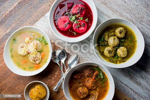 Matzo Ball Soup. Classic soup made with chicken or vegetable stock and matzo balls dumplings. Classic American Restaurant or Diner favorite. Homemade soup with chicken broth, noodles celery carrots seasoned with salt and pepper and garnished with Italian parsley.