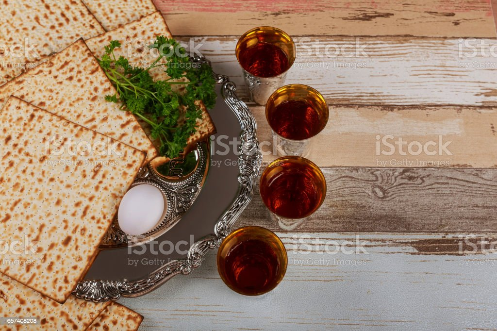 Matzo, egg and wine for passover celebration stock photo