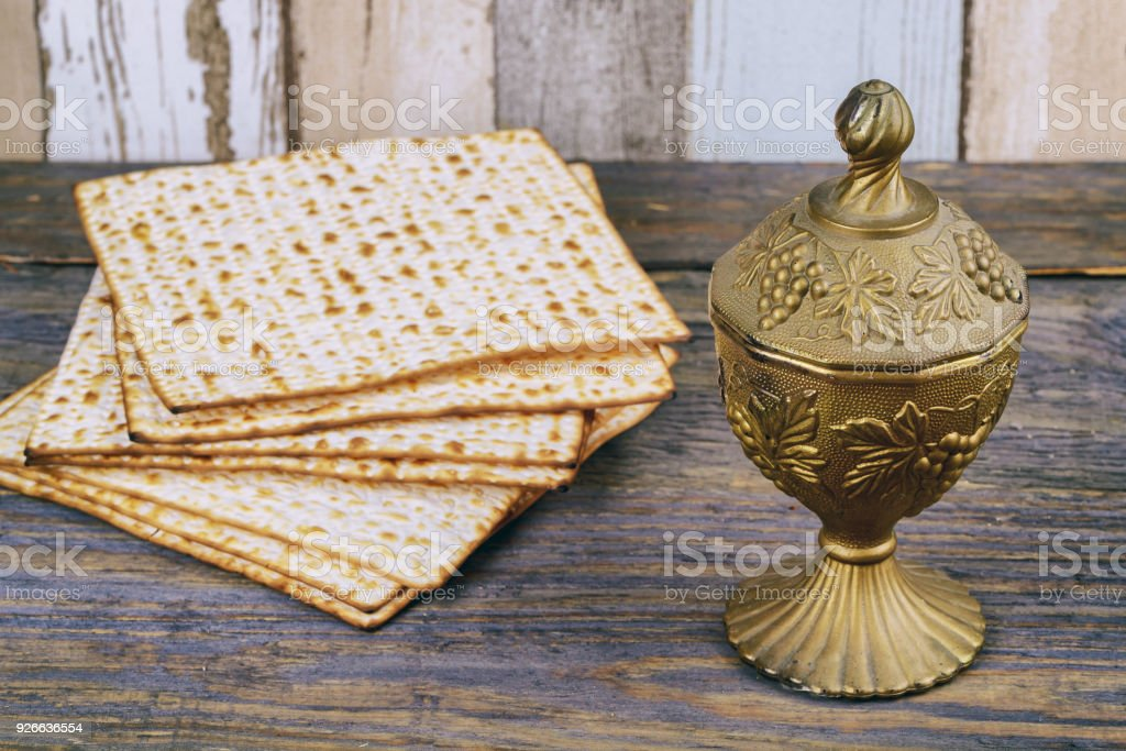 Matzo for Passover with metal tray and wine on table stock photo