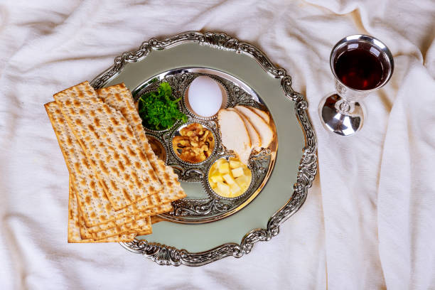 Matzo for Passover with Seder on plate on table close up Matzo for Passover with on seder plate on close up seder plate stock pictures, royalty-free photos & images