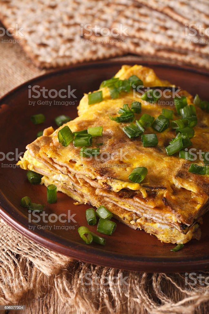 Matzo fried with eggs and green onions - matzah brei stock photo
