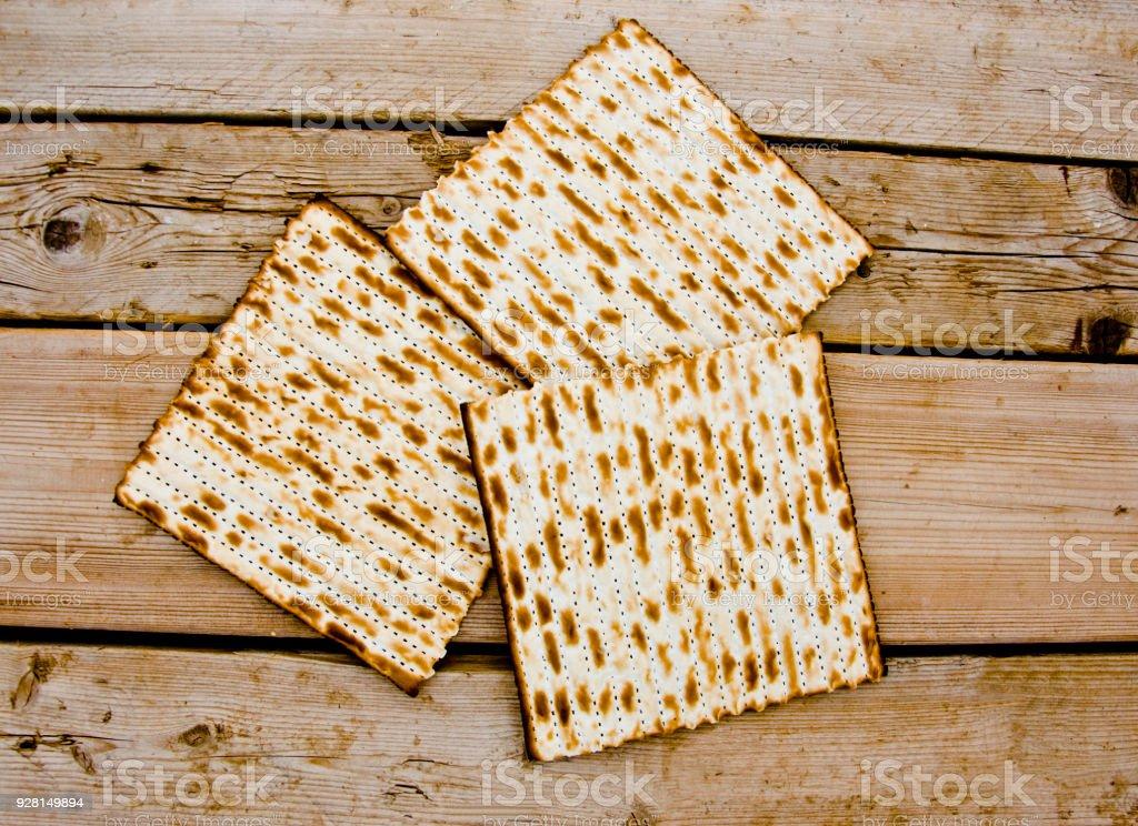 Matzo, Matzoth for Jewish Passover, Wooden Bakcground stock photo