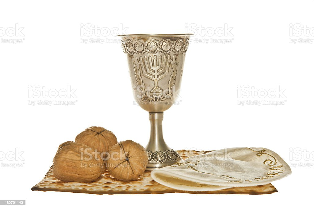 Matzo silver Kiddush cup three walnuts and Yarmulke royalty-free stock photo