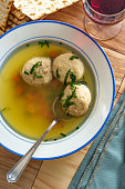Delicious Matzoh ball soup with crackers and wine