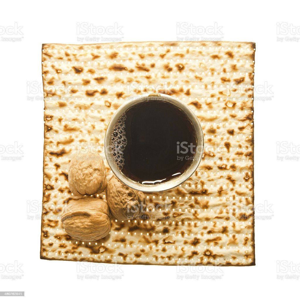 Matzoth, silver Kiddush cup and three walnuts stock photo