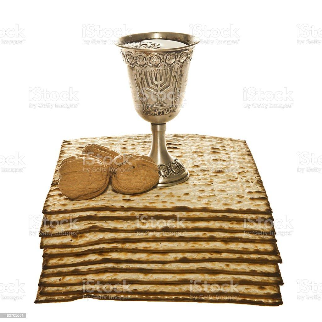 Matzoth, silver Kiddush cup and three walnuts royalty-free stock photo