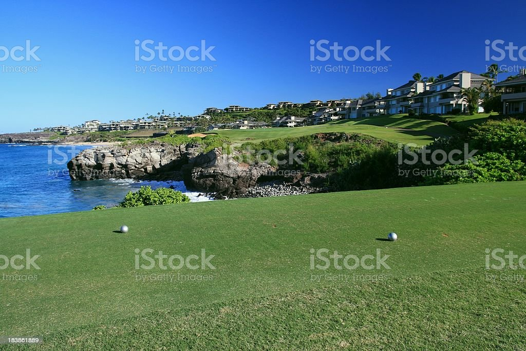 Maui, Hawaii Pacific ocean front resort hotel golf course green stock photo