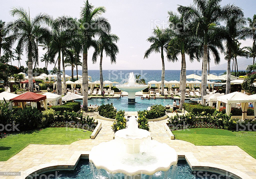 Maui Hawaii palm tree Pacific ocean resort hotel beach scenic stock photo