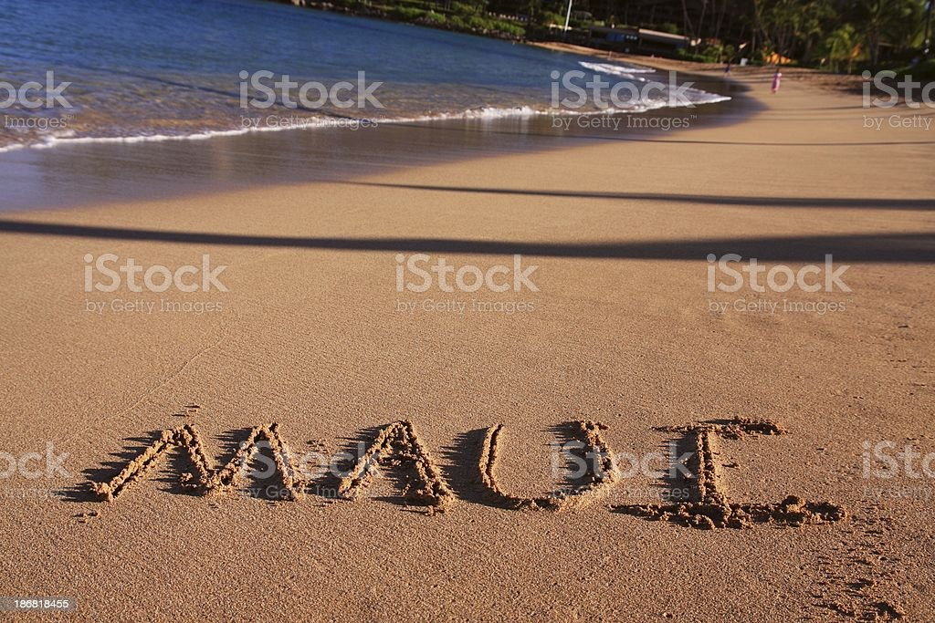 Maui written on Hawaii resort hotel sand beach royalty-free stock photo
