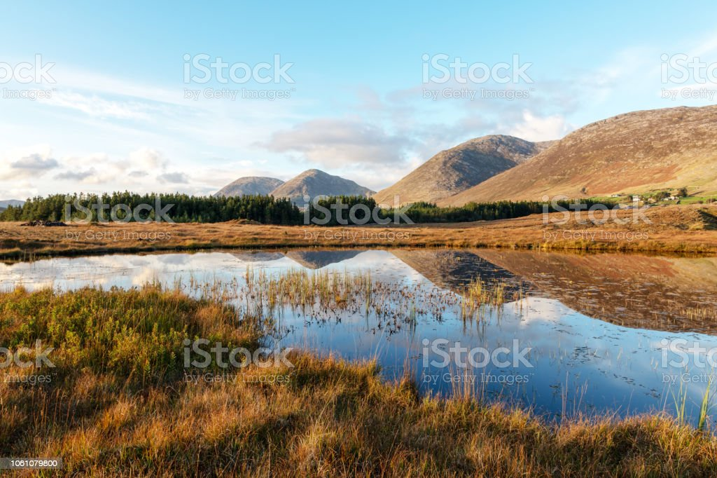 Maumturk Mountans, lake, autumn, sunset, Ireland stock photo