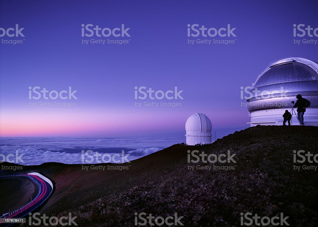Mauna Kea observatories at dusk, Hawaii. stock photo