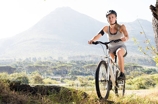 Maure woman cycling stock photo
