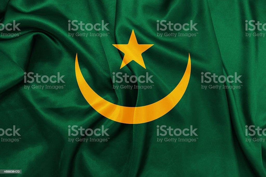 Mauritania - Waving national flag on silk texture stock photo