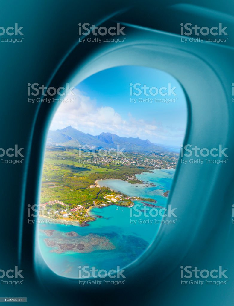 Mauritius island seen from airplane window stock photo