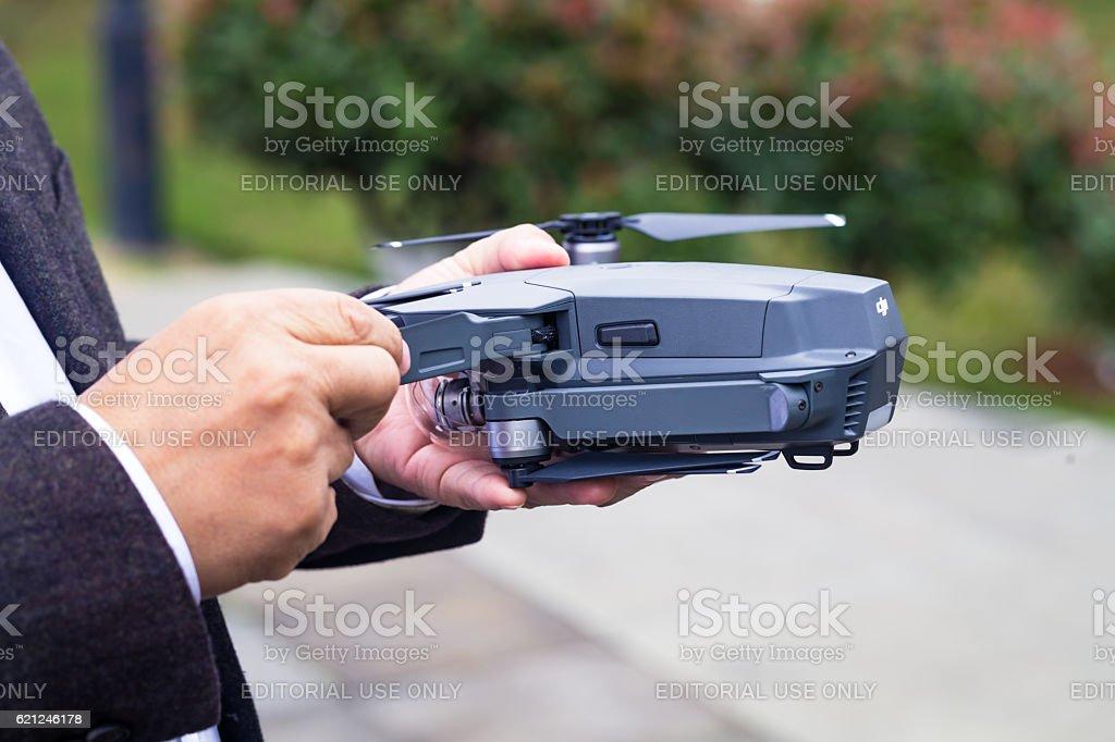 DJI Mavic Pro hold by hand stock photo