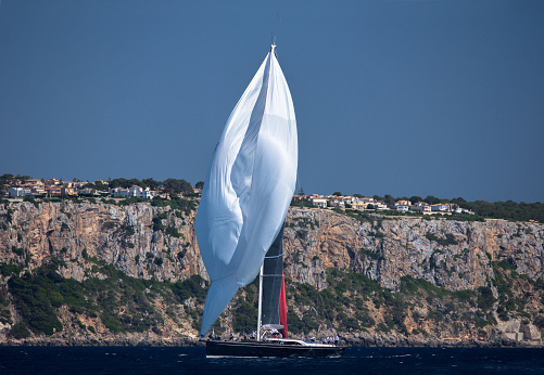 Sailing boat is shifiting sails on the sea during a regatta