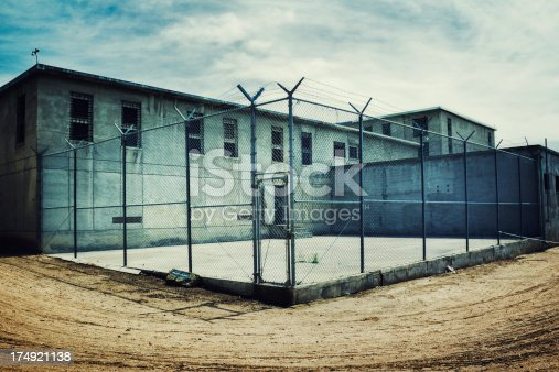 Old maximum security prison yard within a prison yard.