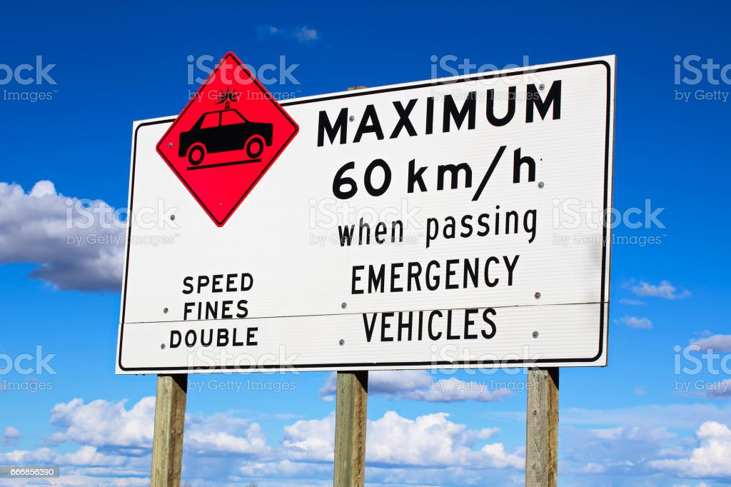 Maximum speed while passing emergency vehicles sign.