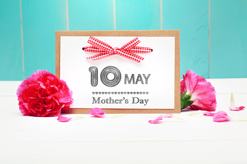 istock May 10th Mothers Day card with pink carnations 491131526