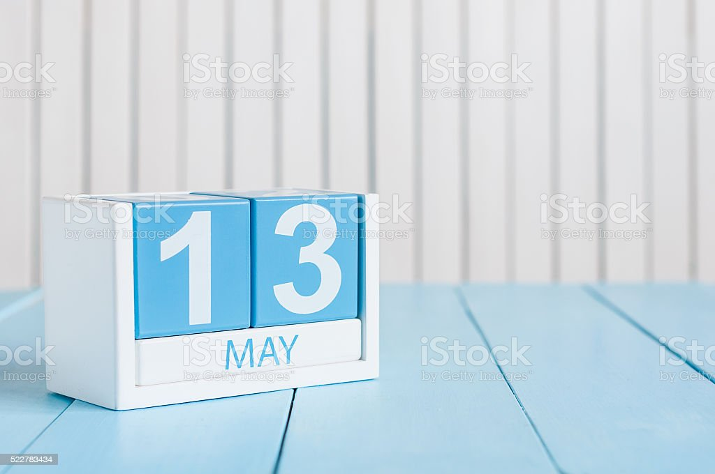 May 13th. Image of may 13 wooden color calendar on stock photo