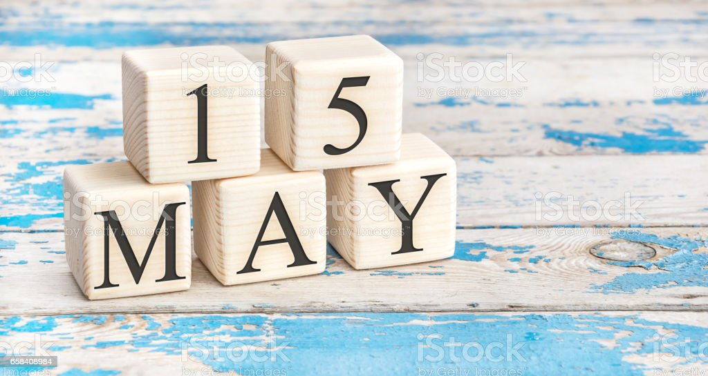 May 15th. Wooden cubes with date of 15 May on old blue wooden background. stock photo