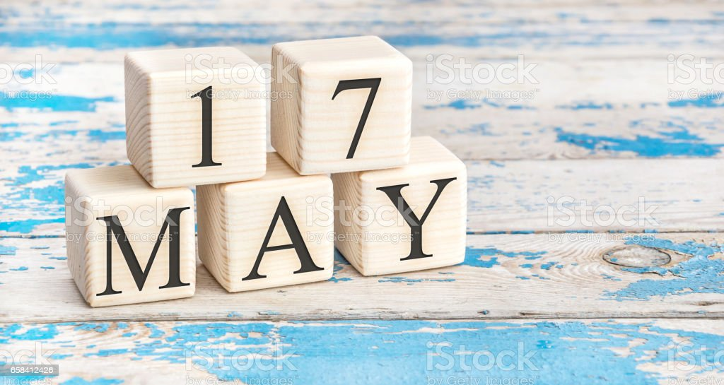 May 17th. Wooden cubes with date of 17 May on old blue wooden background. stock photo