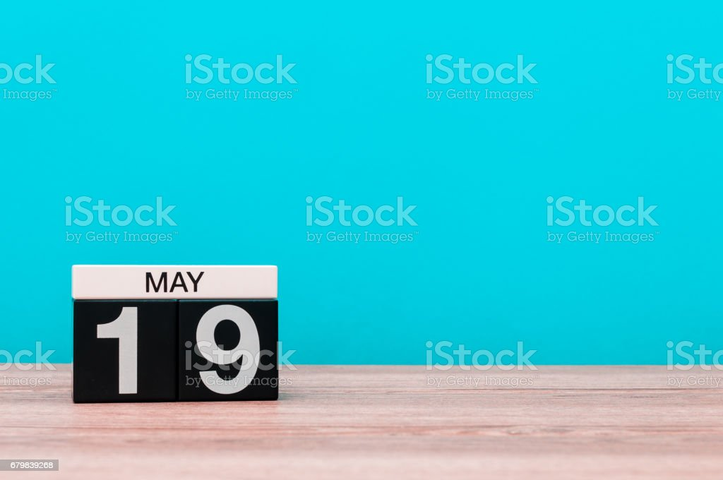 May 19th. Day 19 of month, calendar on turquoise background. Spring time, empty space for text stock photo