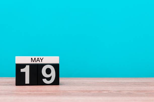 may 19th. day 19 of month, calendar on turquoise background. spring time, empty space for text - number 19 stock photos and pictures