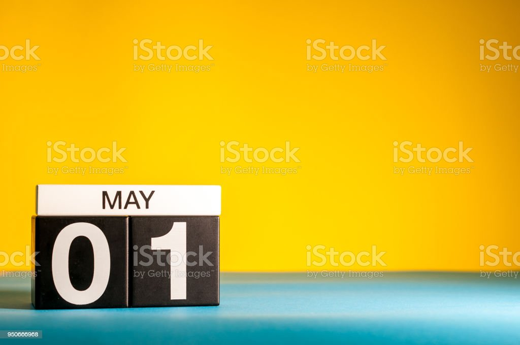 May 1st. Day 1 of may month, calendar on yellow background. Spring time, International labor day stock photo