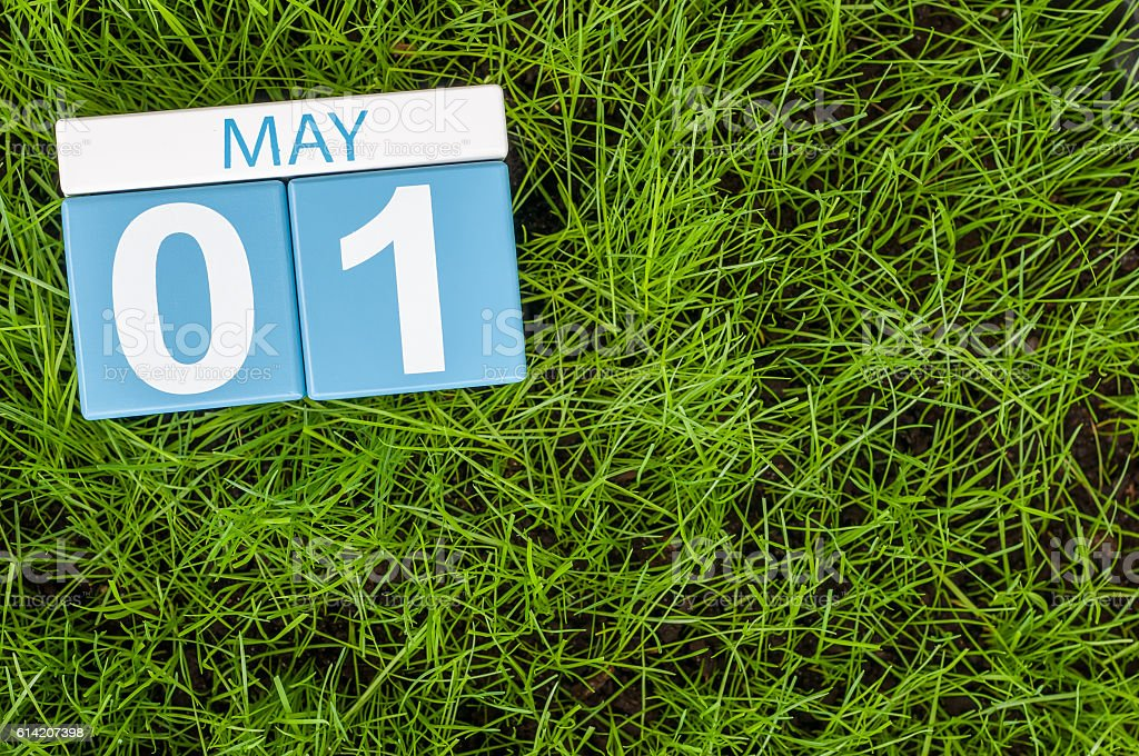 May 1st. Day 1 of month, calendar on football green stock photo