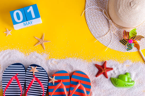 May 1st. Image of may 1 calendar with summer beach accessories. Spring like Summer vacation concept. International Workers' Day stock photo