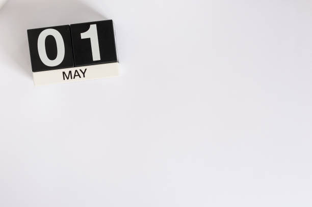 May 1st. Image of may 1 wooden color calendar on white background.  Spring day, empty space for text.  International Workers' Day stock photo