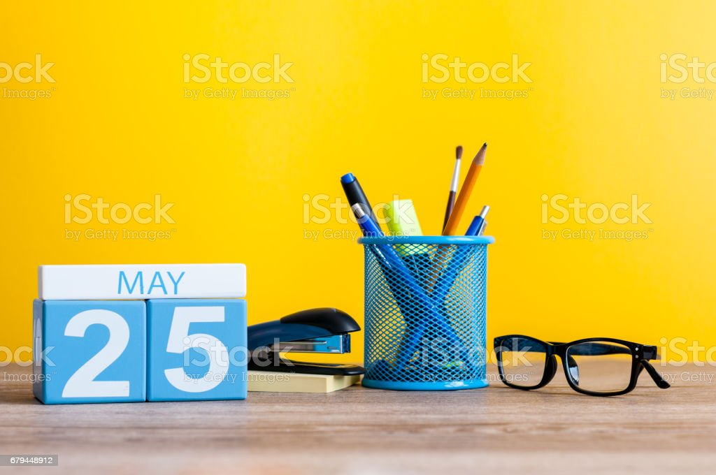 May 25th. Day 25 of month, calendar on business office table, workplace at yellow background. Spring time. International Missing Children Day. World Thyroid DAY stock photo