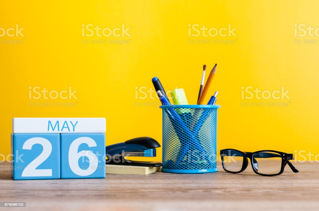 May 26th. Day 26 of month, calendar on business office table, workplace at yellow background. Spring time stock photo