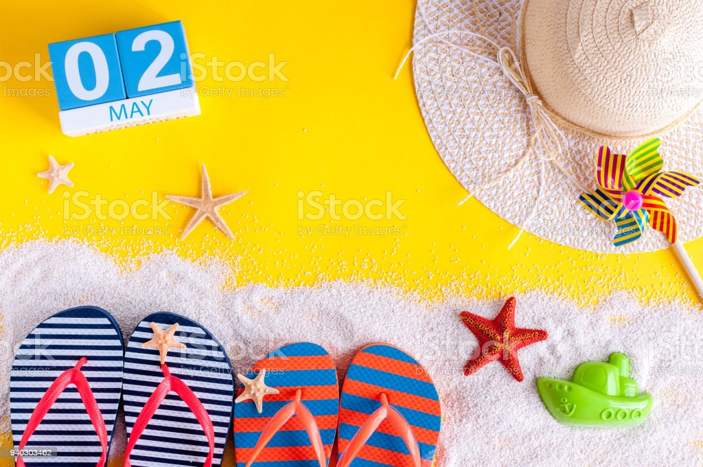 May 2nd. Image of may 2 calendar with summer beach accessories. Spring like Summer vacation concept stock photo