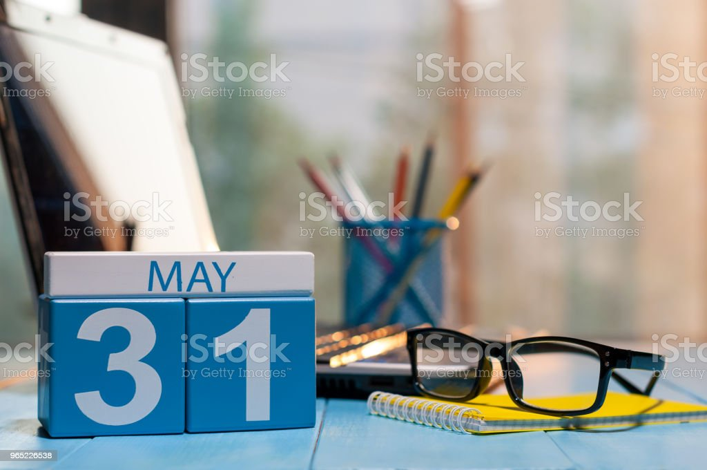 May 31st. Day 31 of month, calendar on business office background, workplace with laptop and glasses. Spring time, empty space for text royalty-free stock photo