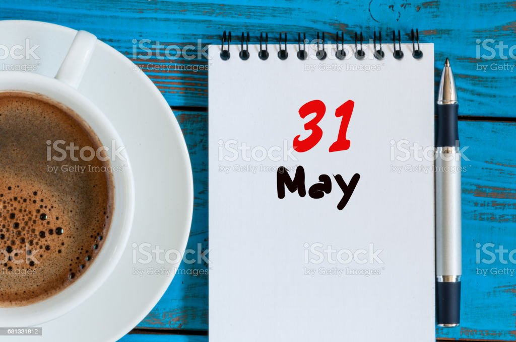 May 31st. Day 31 of month, calendar on white notepad with morning coffee cup at work place background. Spring time, Top view stock photo