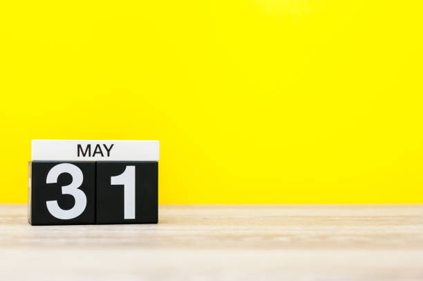 May 31st. Image of may 31 calendar on yellow background. Last spring day, Spring end. Empty space for text. World blondes Day stock photo