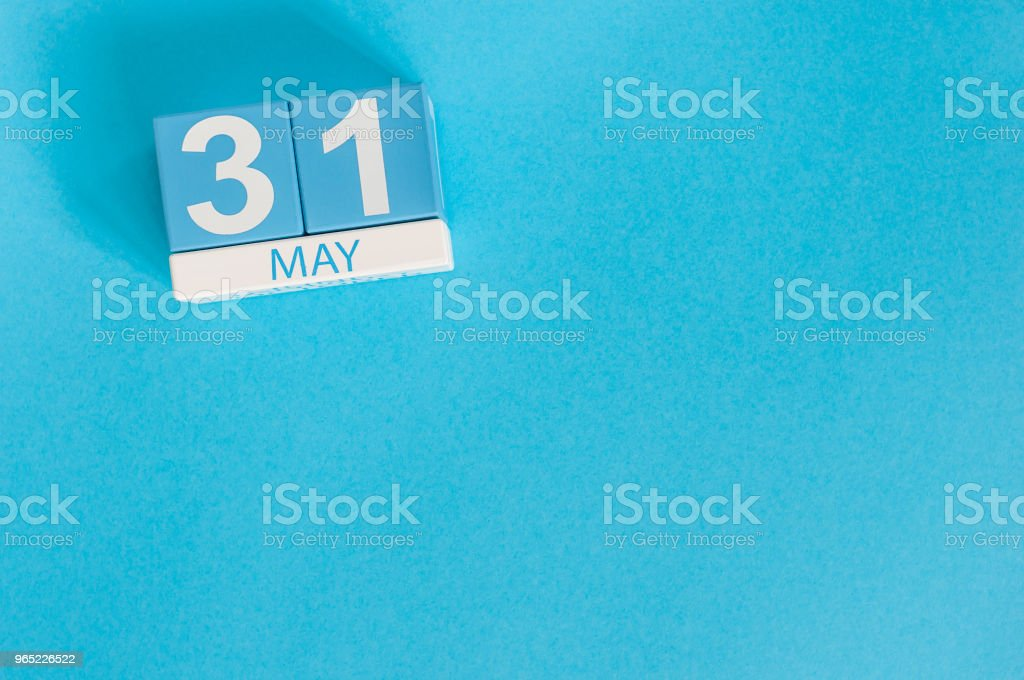 May 31st. Image of may 31 wooden color calendar on blue background.  Last spring day, Spring end. Empty space for text. World blondes Day zbiór zdjęć royalty-free